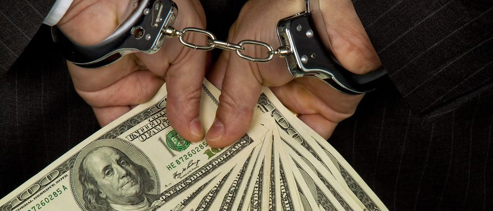 Man arrested for fraud.