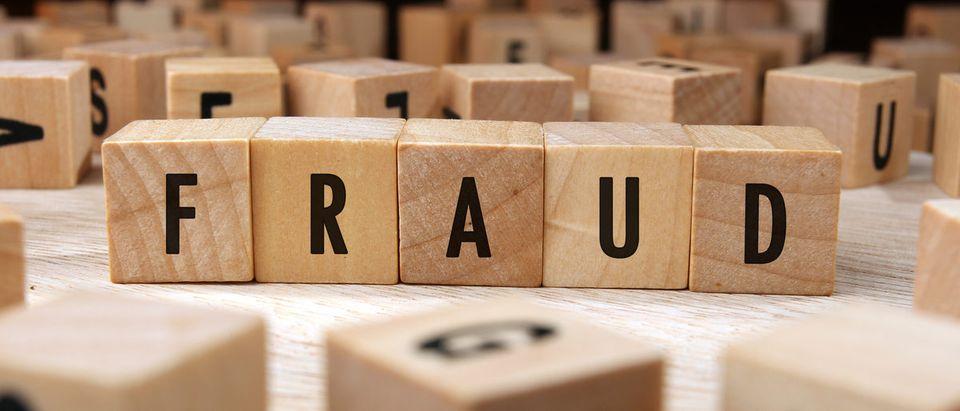 """Fraud"" written on wooden blocks."