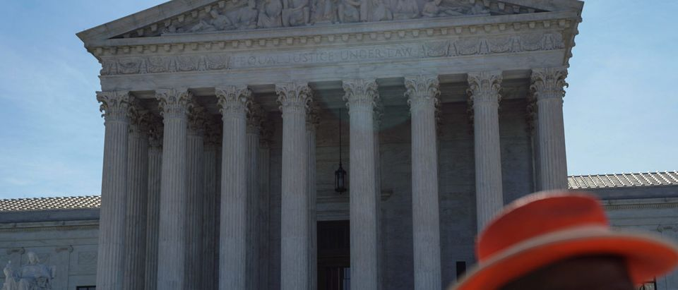 Visitors wait to enter the U.S. Supreme Court in Washington
