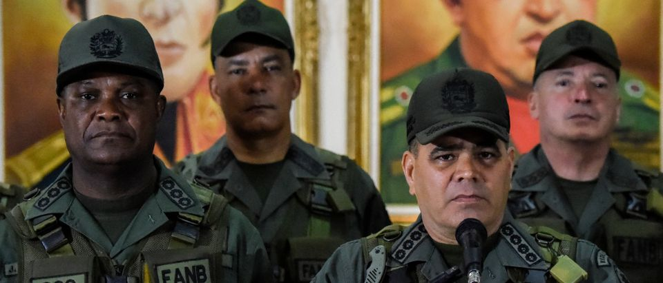 "Venezuelan Defence Minister Padrino Lopez (2-R) flanked by the military high command, delivers a press conference in Caracas on August 05, 2018, a day after an alleged attack using explosive-laden drones during a military parade took place. - Venezuelan President Nicolas Maduro said he was ""more determined than ever"" after he escaped an ""assassination"" attempt as he gave a speech during a Caracas military parade. The government said seven soldiers were wounded in the alleged attack Saturday, blamed on Colombia by Maduro and later claimed by a mysterious rebel group. (Photo by Juan BARRETO / AFP) (Photo credit should read JUAN BARRETO/AFP/Getty Images)"