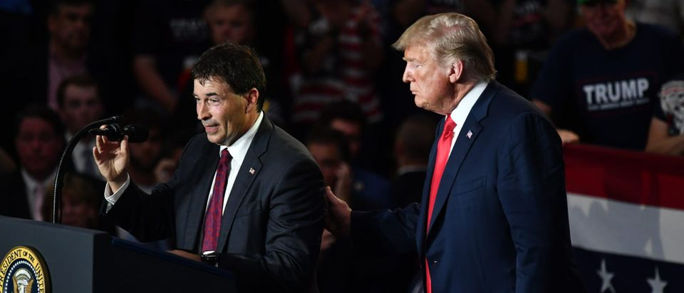 Republican congressional candidate Troy Balderson (L) speaks next to US President Donald Trump during a rally at Olentangy Orange High School in Lewis Center, Ohio, on August 4, 2018. Photo by MANDEL NGAN / AFP