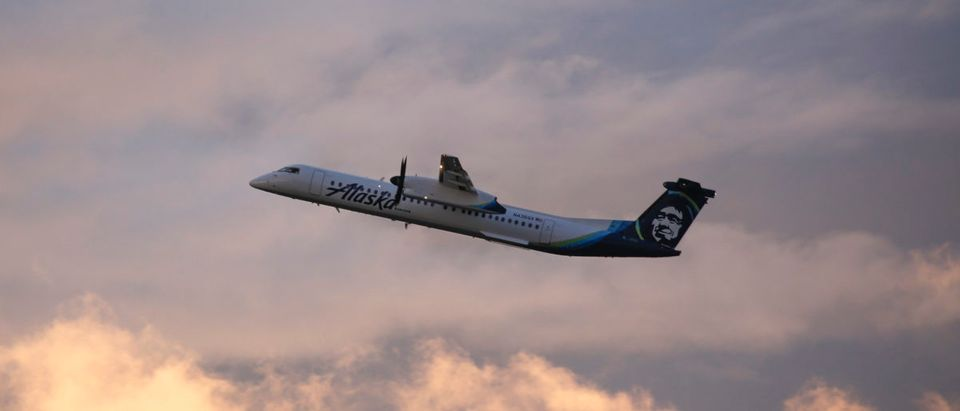 An Alaska Airlines Bombardier Dash 8 Q400 operated by Horizon Air takes off from at Seattle-Tacoma International Airport International Airport one day after Horizon Air ground crew member Richard Russell took a similar plane from the airport in Seattle, Washington on August 11, 2018. JASON REDMOND/AFP/Getty Images