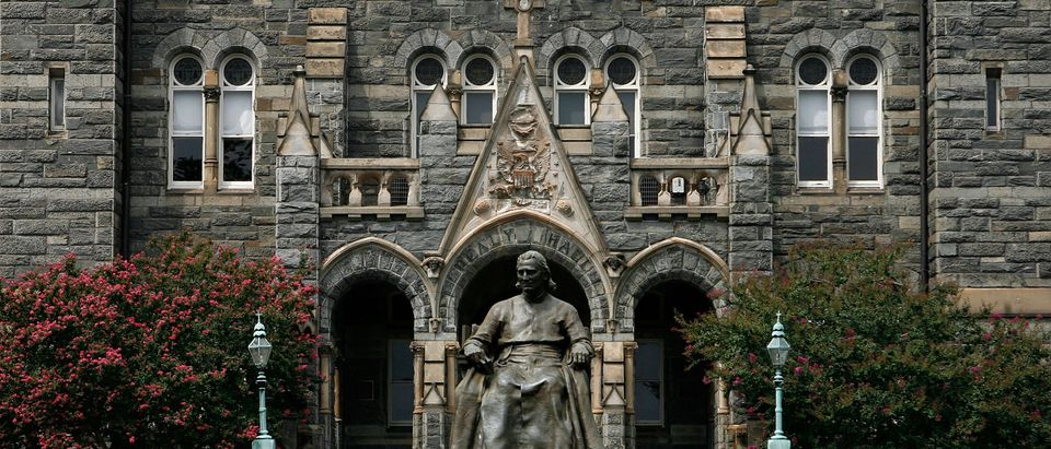 A statue of John Carroll, founder of Georgetown University, sits before Healy Hall on the school's campus August 15, 2006 in Washington, DC. Photo by Alex Wong/Getty Images