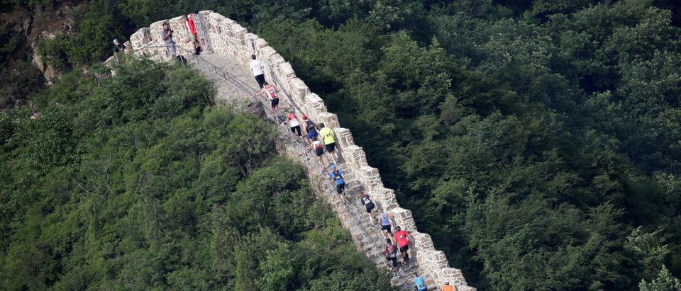 Participants attend the Great Wall Marathon at the Huangyaguan section of the Great Wall of China, in Jixian of Tianjin, China May 19, 2018. REUTERS/Jason Lee