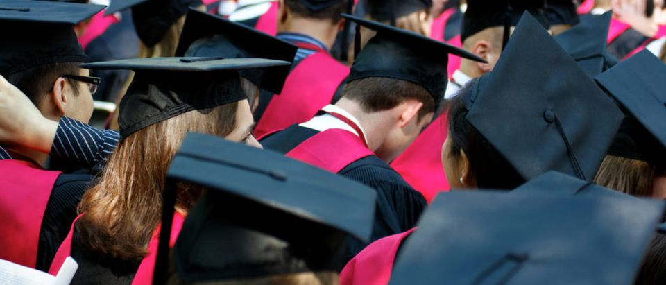 CAMBRIDGE, MA - MAY 26: Students of Harvard University gather for their graduation ceremonies on Commencement Day on May 26, 2011 in Cambridge, MA. (Shutterstock/Jannis Tobias Werner)