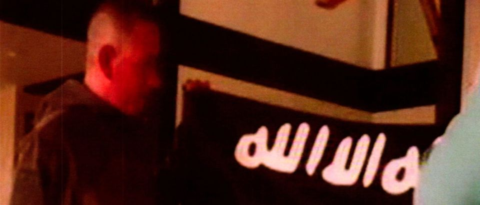 Government court exhibit shows what is described as U.S. Army Sergeant Ikaika Erik Kang holding the Islamic State Flag
