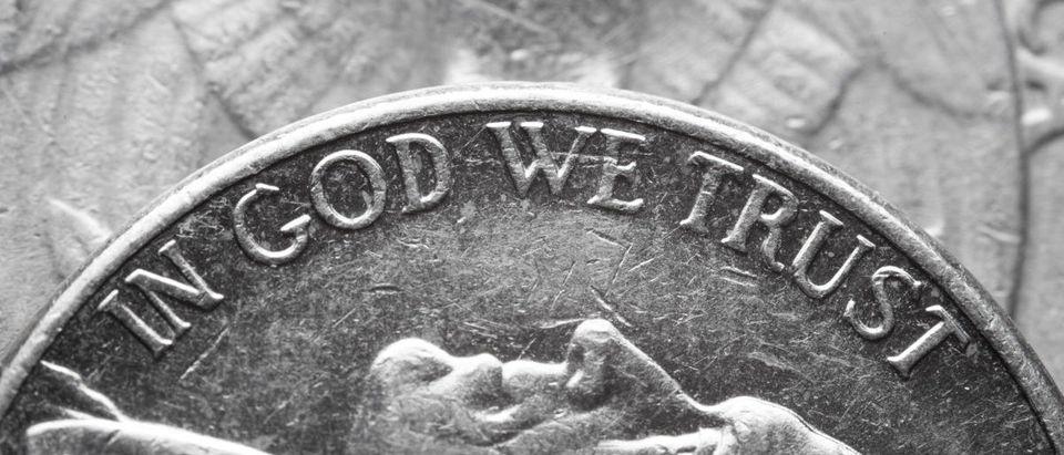 In God We Trust Writte On A Coin -- ShutterStock Ahturner