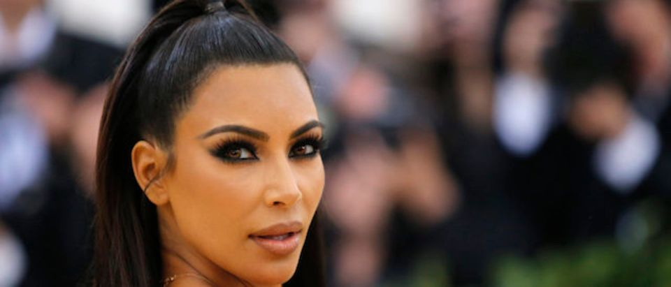 Kim Kardashian arrives at the Metropolitan Museum of Art Costume Institute Gala (Met Gala) to celebrate the opening of ìHeavenly Bodies: Fashion and the Catholic Imaginationî in the Manhattan borough of New York, U.S., May 7, 2018. REUTERS/Eduardo Munoz