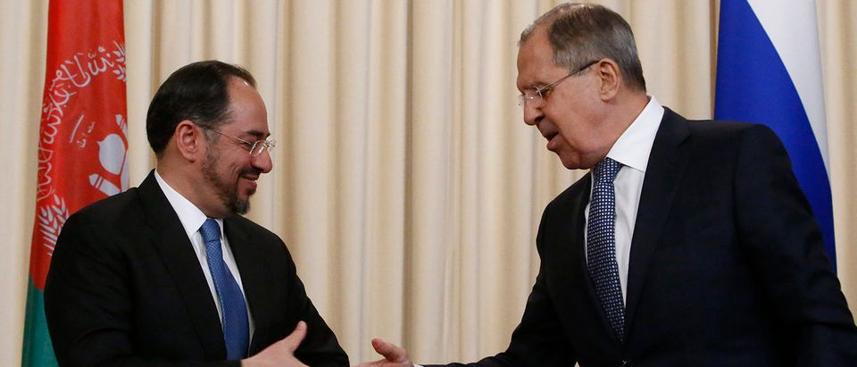 Russian Foreign Minister Sergei Lavrov and his Afghan counterpart Salahuddin Rabbani shake hands during a joint news conference following their meeting in Moscow, Russia February 7, 2017. REUTERS/Sergei Karpukhin