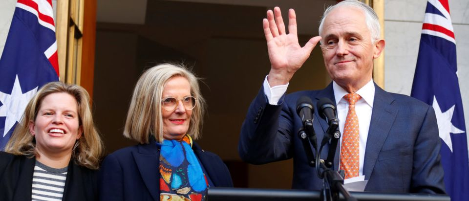 Former Australian Prime Minister Malcolm Turnbull waves next to wife Lucy and daughter Daisy after a news conference in Canberra