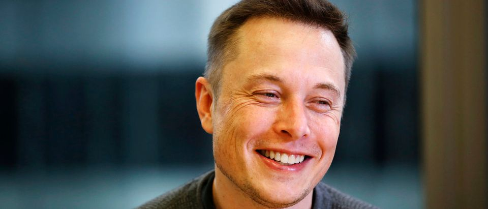 Elon Musk, chief cxecutive of Tesla Motors and SpaceX, smiles during the Reuters Global Technology Summit in San Francisco June 18, 2013. REUTERS/Stephen Lam
