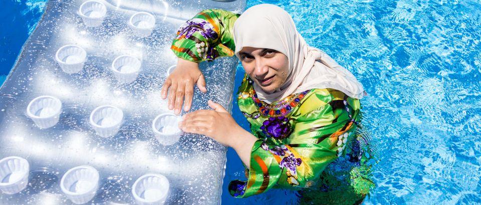 A Muslim swimming in Islamic clothing (Shutterstock/ Zurijeta)