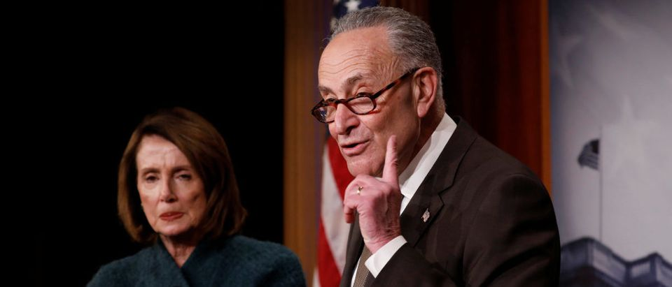 Chuck Schumer speaks at a news conference about the omnibus spending bill moving through Congress on Capitol Hill in Washington