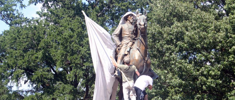 MEMPHIS - AUG 19: Protesters attempt to drape Nathan Bedford Forrest statue in a canvas calling for its removal in the #TakeEmDown901 campaign to dismantle confederate propaganda, August 19, 2017. (Shutterstock/L. Kragt Bakker)
