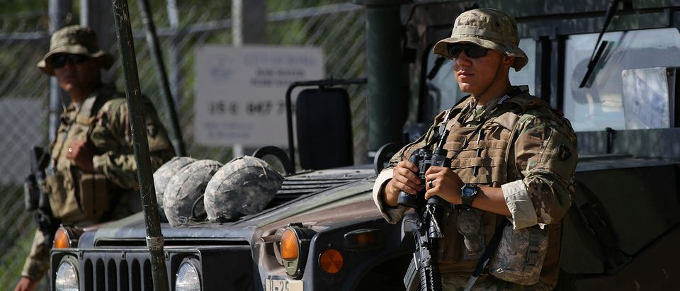 Members of the Texas National Guard watch the Mexico-U.S. border from an outpost along the Rio Grande in Roma