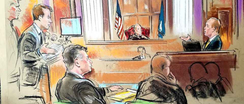 Rick Gates (R), a longtime business associate of U.S. President Donald Trump's former campaign chairman Paul Manafort (front L), testifies on the fifth day of the trial of Manafort, on bank and tax fraud charges stemming from Special Counsel Robert Mueller's investigation into Russian meddling in the 2016 U.S. presidential election, in federal court in Alexandria, Virginia, U.S., August 6, 2018. Judge T.S. Ellis (rear C) looks on. REUTERS/Bill Hennessy