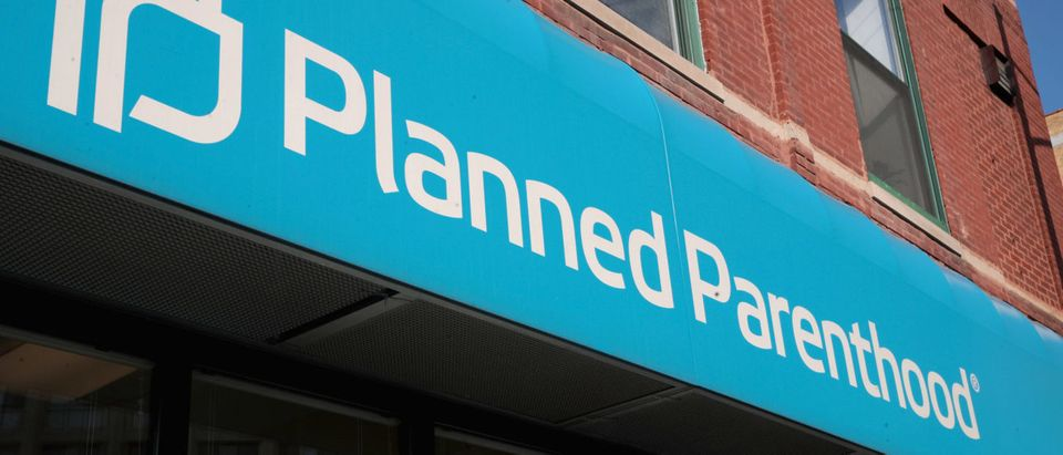 CHICAGO, IL - MAY 18: A sign hangs above a Planned Parenthood clinic on May 18, 2018 in Chicago, Illinois. The Trump administration is expected to announce a plan for massive funding cuts to Planned Parenthood and other taxpayer-backed abortion providers by reinstating a Reagan-era rule that prohibits federal funding from going to clinics that discuss abortion with women or that share space with abortion providers. (Photo by Scott Olson/Getty Images)