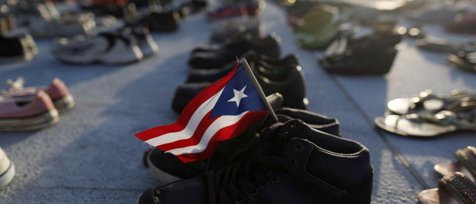 A Puerto Rican flag is seen on a pair of shoes as hundreds of pairs of shoes displayed at the Capitol to pay tribute to Hurricane Maria's victims in San Juan