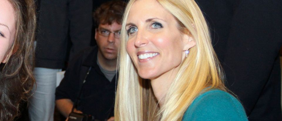 U.S. political commentator Ann Coulter poses for a photo and sign books at the conclusion of her speaking engagement to a sold out crowd in Calgary