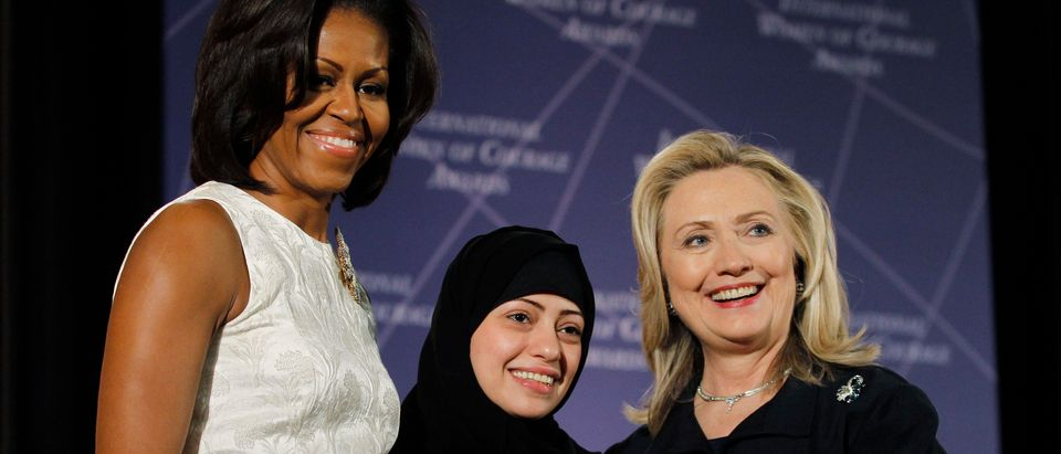U.S. Secretary of State Hillary Clinton and First lady Michelle Obama (L) congratulate Samar Badawi of Saudi Arabia during the State Department's 2012 International Women of Courage Award winners ceremony in Washington March 8, 2012. REUTERS/Gary Cameron