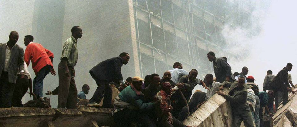 FILE PHOTO: An injured man is rescued from the site of the bombing of the U.S. Embassy building in Nairobi, Kenya