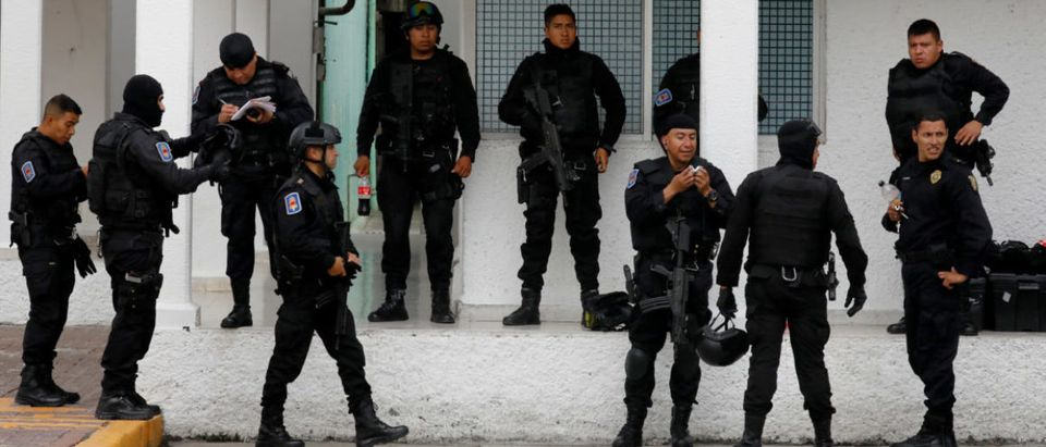 """Police officers, members of a team known as """"Condores"""", rest after they a patrol the city, part of a new strategy to combat the crime in Mexico City,"""