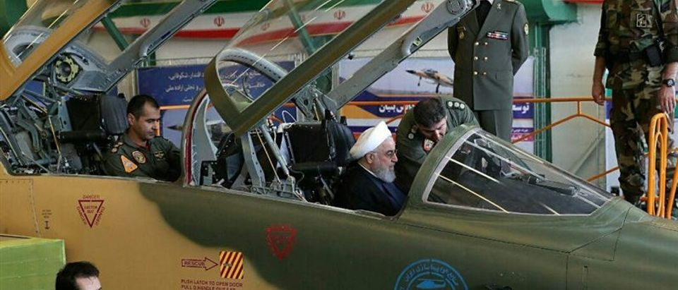 Iranian President Hassan Rouhani is seen in a newly unveiled fighter jet in Tehran