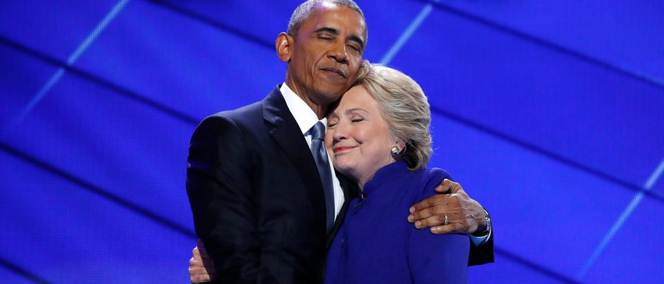 Democratic presidential nominee Clinton hugs U.S. President Obama as she arrives onstage at the end of his speech on the third night of the 2016 Democratic National Convention in Philadelphia