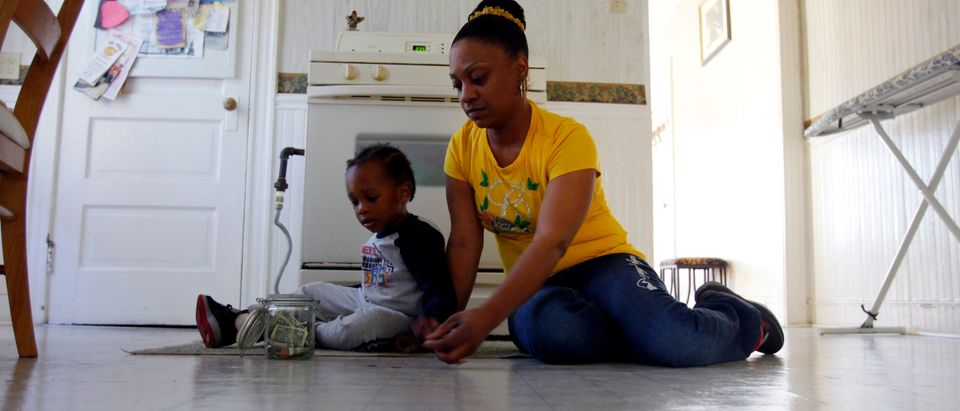 April Metts plays with her two-year old son Jamar at her apartment in Providence