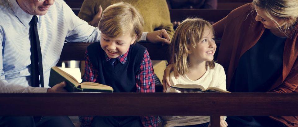 Religious Parents Teach Their Children (Shutterstock/ Rawpixel.com)