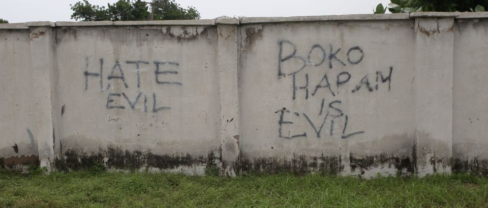 FILE PHOTO: Writings describing Boko Haram are seen on the wall along a street in Bama