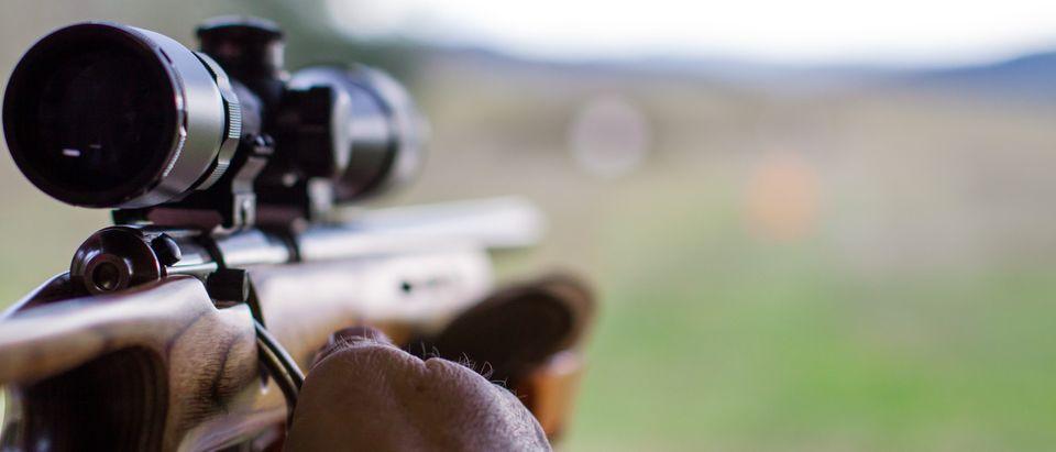 Rifle pointing at range