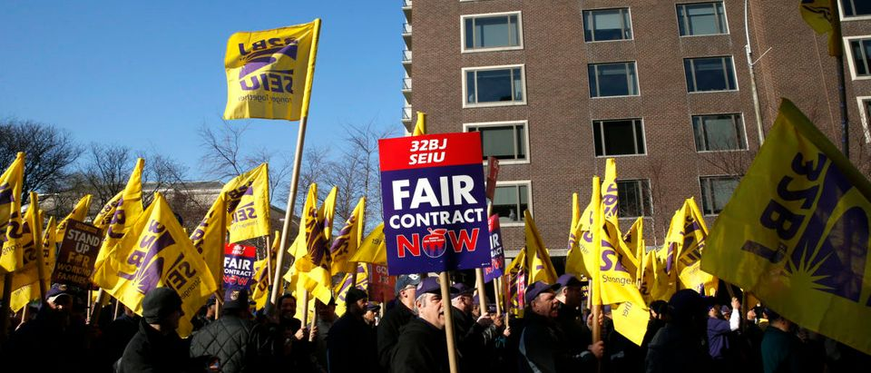 Members of the Service Employees International Union (SEIU) march during a protest in support of a new contract for apartment building workers in New York City