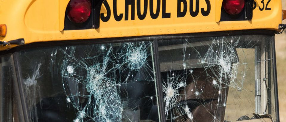 A school bus with bullet holes is pictured. (Shutterstock/Puffin's Pictures)