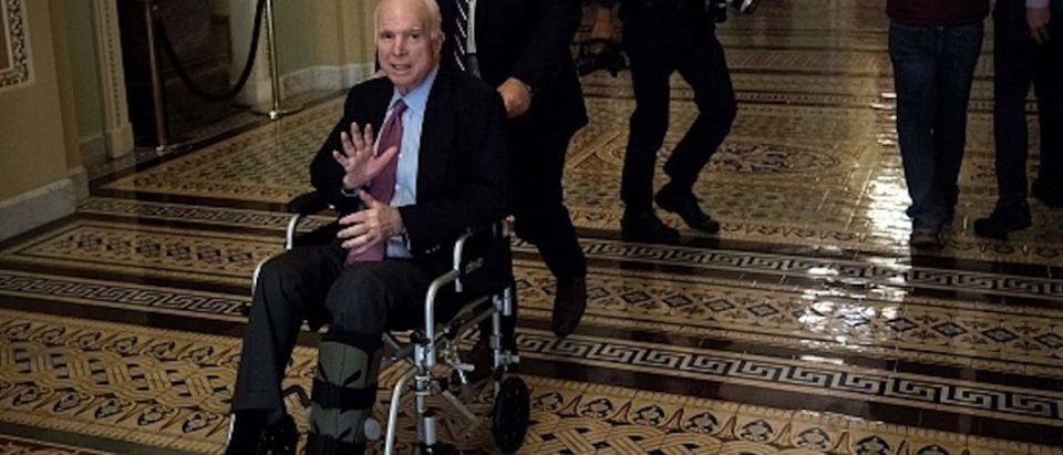 """Sen. John McCain uses a wheelchair on Capitol Hill December 1, 2017 in Washington, D.C. Donald Trump's tax reform plan has overcome pockets of resistance within Republican ranks, US senators said Friday, setting up a vote that could provide the president with his first major legislative victory.""""We have the votes,"""" Senate Majority Leader Mitch McConnell told reporters as he entered the chamber. (Photo: BRENDAN SMIALOWSKI/AFP/Getty Images)"""