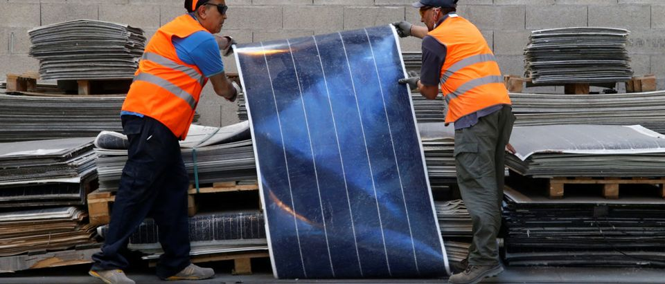 Employees work at Veolias solar panel recycling plant in Rousset