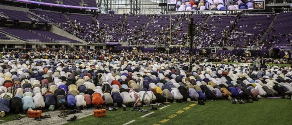 Muslim worshippers kneel in prayer at the U.S. Bank Stadium during celebrations for Eid al-Adha on August 21, 2018 in Minneapolis, Minnesota. (Photo: KEREM YUCEL/AFP/Getty Images)