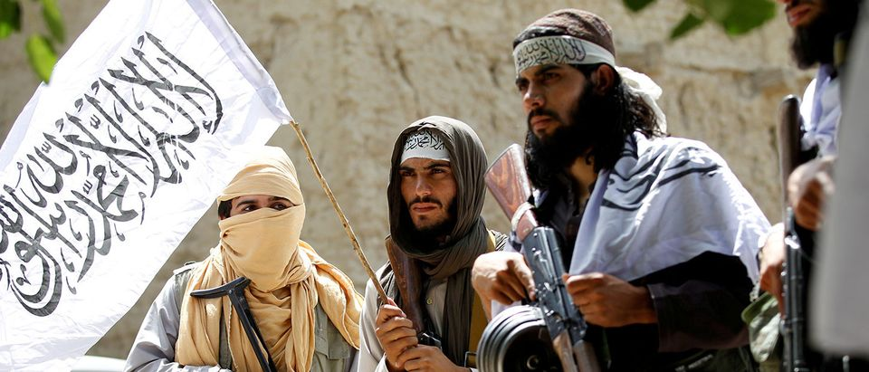 FILE PHOTO: Taliban walk as they celebrate ceasefire in Ghanikhel district of Nangarhar province, Afghanistan