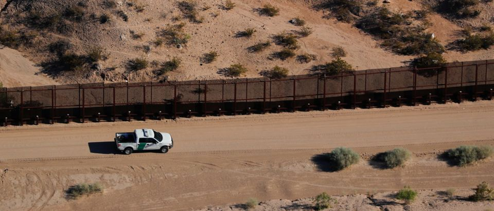 A U.S. border patrol truck drives along thew border fence between Mexico and Sunland Park, New Mexico