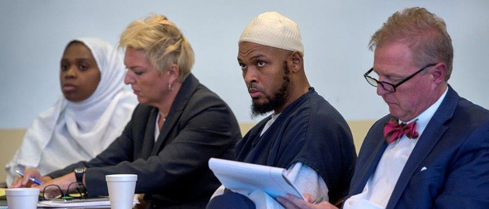 Defendant Jany Leveille sits next to her defense lawyer Kelly Golightley, defendant Siraj Ibn Wahhaj and his defense lawyer Tom Clark at hearing in Taos County District Court in Taos County