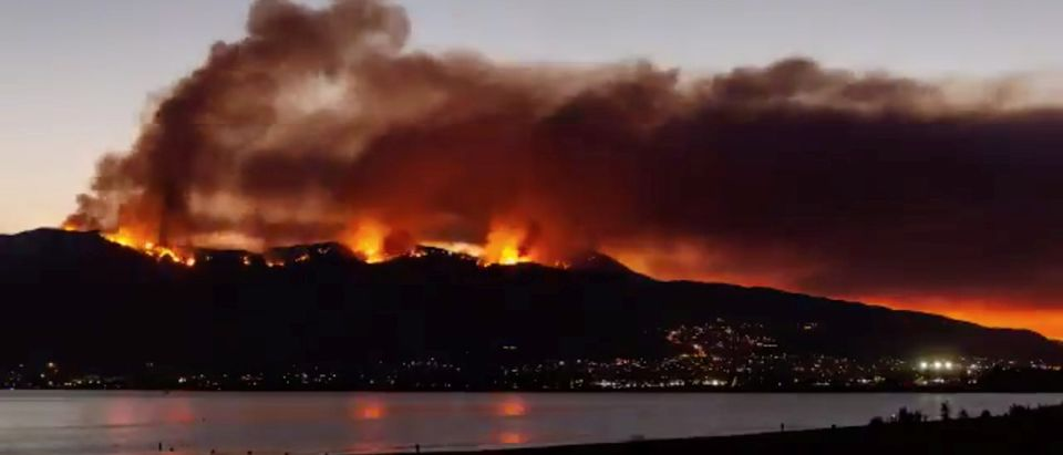 Smoke rises as the Holy Fire spreads along Lake Elsinore