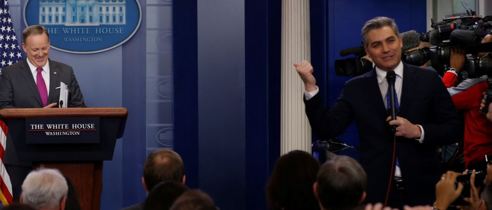 Spicer waits for Acosta to finish speaking on camera before he starts the daily press briefing at the White House in Washington