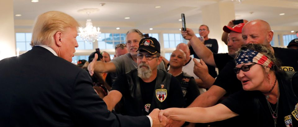 "U.S. President Donald Trump meets with supporters from a group called ""Bikers for Trump"" at the Trump National Golf Club in Bedminster"