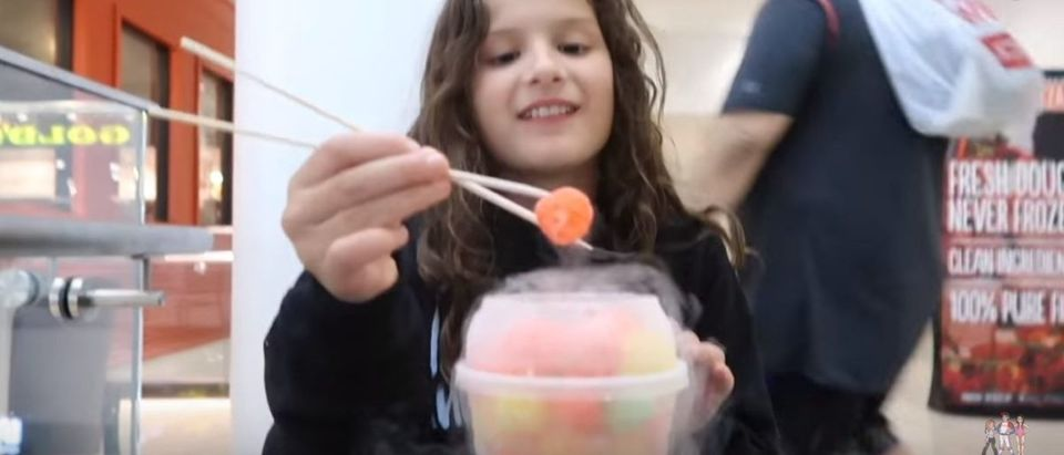 "A child eats ""Dragons Breath."" YouTube screenshot/Bratayley"
