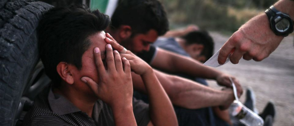 A man from Guatemala reacts after he is apprehended with others who illegally crossed into the U.S. border from Mexico in Penitas, Texas