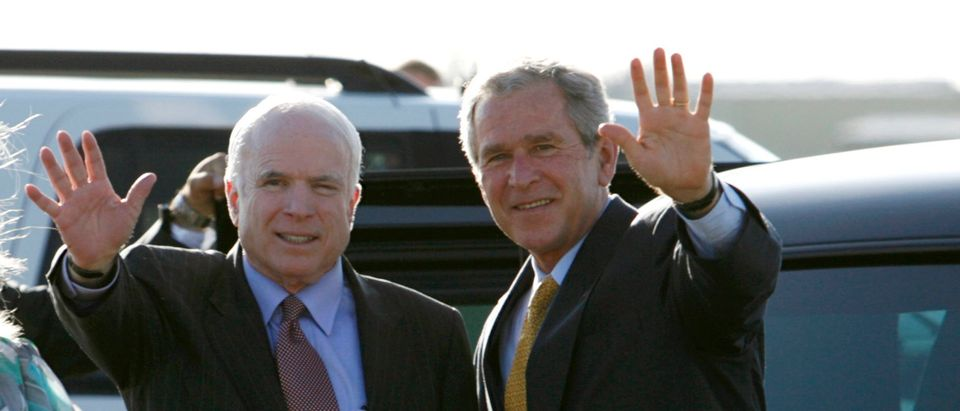 U.S. President George W. Bush is greeted at Sky Harbor Airport by Republican Presidential candidate John McCain after Bush spoke at a McCain campaign fund raising event in Phoenix, Arizona, May 27, 2008. At left is Cindy McCain. REUTERS/Kevin Lamarque