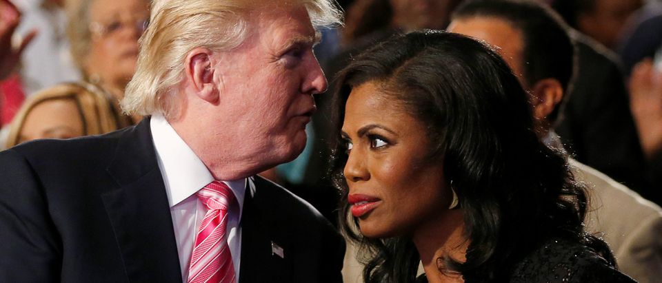 Republican presidential nominee Donald Trump and Omarosa Manigault (R) attend a church service, in Detroit, Michigan