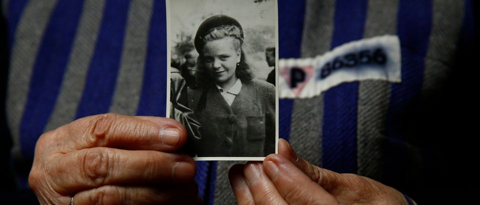 Auschwitz death camp survivor Jadwiga Bogucka (maiden name Regulska), 89, registered with camp number 86356, holds a picture of herself from 1944 in Warsaw January 12, 2015. As the liberation of Auschwitz approaches its 70th anniversary this month, Reuters photographers took portraits of now elderly survivors. About 1.5 million people, most of them Jews, were killed at the Nazi camp which has became a symbol of the horrors of the Holocaust and World War Two, which ravaged Europe. The camp was liberated by Soviet Red Army troops on January 27, 1945 and about 200,000 camp inmates survived. REUTERS/Kacper Pempel