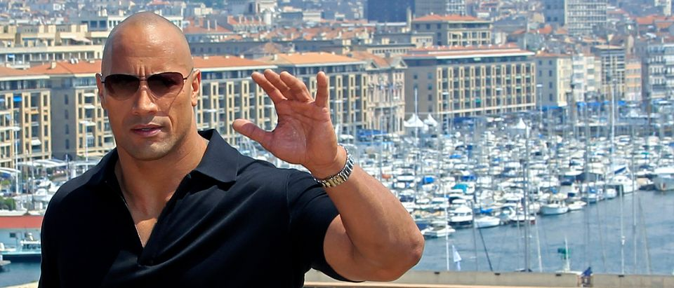 "Cast member Dwayne Johnson poses during a photocall at the premiere of the film ""Fast and Furious 5"" in Marseille, April 28, 2011. REUTERS/Jean-Paul Pelissier"