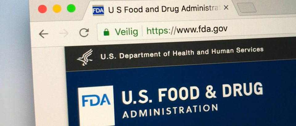 A screen shows the FDA website. Shutterstock image via Jarretera